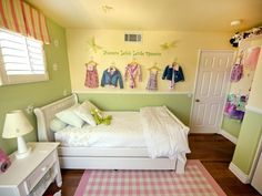 Little Girl Bedroom ~ love the two tone walls with chair rail and the solid wall with decals. Inspiring ~ makes me want to redo my little darling's room.