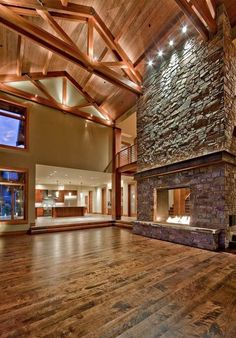 awesome stone fireplace design accent lighting cathedral ceiling wood flooring