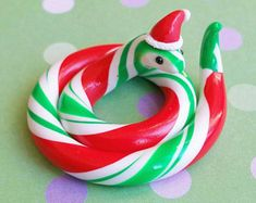 Tiny Wintergreen Candy Cane Snake Figurine. Polymer Clay Christmas Item, Crafted By The Clay Kiosk on Etsy.