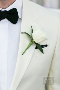White tux, classic bout & a hint of polka dots!! Love it