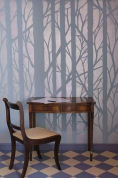 Tree trunk stenciled wall with metallic paint