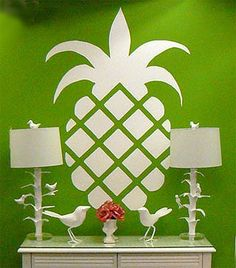 The pineapple is the international symbol for hospitality. Think this would look cool stenciled on my concrete porch just as you step up on the porch!