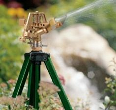 Orbit Lawn Watering Impact Sprinkler on Tripod Base by Orbit. $55.14. This Orbit impact sprinkler sits on a tripod base that is easy to transport and position. Built of durable zinc metal, this impact sprinkler head guarantees many years of dependable use. This Orbit sprinkler head works with above-ground garden watering systems or on its own. With an anti-backsplash arm and deflector, this water sprinkler has quiet and smooth rotation while distributing water only where it ne...