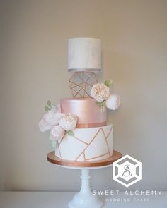 Modern copper and rose gold wedding cake with copper geometric pattern, light marble swirl, rose gold shimmer and fluffy blush sugar flowers. From Sweet Alchemy Wedding Cakes