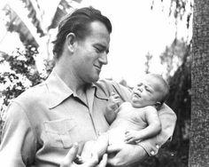 John Wayne cuddles his son Patrick born in 1939