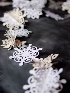 Paper Snowflake Garland. I see future decorating ideas for the PICU this year.