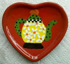 SPOON REST: I painted this ceramic spoon rest, Mary Englebreit style