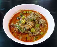 Beef in ground peanut-coconut cream curry