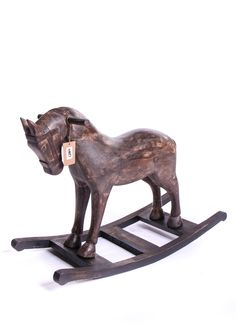 Hand carved solid wood rocking horse.