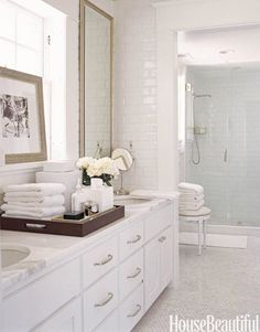 Cheaper white subway tile mixed with luxurious Carrera marble - love