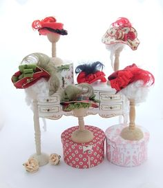 Various red silk, felt and cotton hats