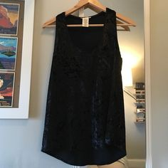 Urban Outfitters Cope black velvet top size Large Urban Outfitters black velvet sleeveless top size large. Super cute and worn only once. Has a small pocket on top on the left Urban Outfitters Tops Tank Tops