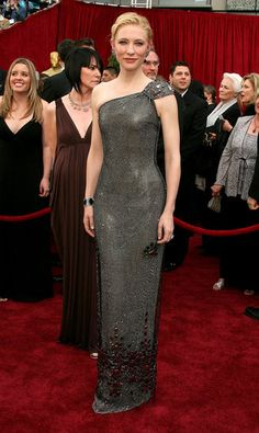 Cate the Great: Her Most Fashion-Forward Red Carpet Moments of All Time!: At The Curious Case of Benjamin Button premiere in LA, Cate pushed the style envelope in an embellished fit-and-flare dress by Alexander McQueen.  : The armor-like Armani Privé gown Cate chose for the 79th Annual Academy Awards helped land her on our best-dressed list.