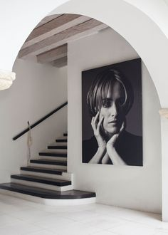 A black-and-white portrait of local fashion designer Silvia Tcherassi hangs prominently in the entryway of her eponymous hotel.