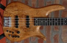 Fodera Monarch Deluxe 1985 4 string bass guitar with the early / rare wood inlaid butterfly wings for sale here @ www.LuthiersAccessGroup.com