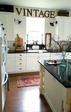 White Industrial Farmhouse Kitchen makeover painted cabinets Boho eclectic Rug Brass