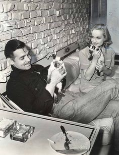 Clark Gable and Carole Lombard at home with kitties.