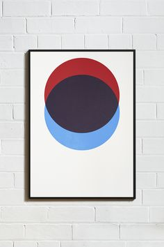 CIRCLES – RED AND BLUE HAND-PULLED SCREEN PRINT Hand-screen printed onto beautifully textured paper made in England. Colours are bright red and bright blue with the two elements overlapping to produce a rich burgundy. Available unframed or framed in an aluminium matt black finish. Size: 50cm x 70cm. Unframed: £35, Framed: £80