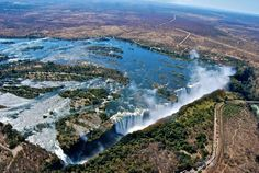 Victoria Falls. Victoria Falls, or Mosi-oa-Tunya, is a waterfall in southern Africa on the Zambezi River at the border of Zambia and Zimbabwe. While it is neither the highest nor the widest waterfall in the world, it is classified as the largest, based on its width of 1,708 metres (5,604 ft) and height of 108 metres (354 ft), resulting in the world's largest sheet of falling water.  Follow AmiPlanet on pinterest.com/AmiPlanet/