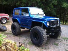 Blue flat fendered Suzuki Samurai