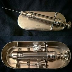 A 1910-20 antique syringe 'new old stock ' never been used with a set of needle cleaning wires and spare asbestos seal and two unused hypodermic needles
