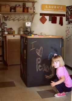 old dishwasher painted with chalkboard paint.