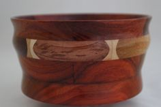 The Exotic Woods Bowl has 19 pcs of exotic woods:Hawaiian Sweet Gum (Hawaii) lt tan with green & red hues, Monkey Pod (C&S America) tan with dark streaks, Ebony (SE Asia) light brown, Purpleheart (S America) purple; Bubinga (Africa) light red with dark streaks, Canarywood (S America) yellow with blue & red hues, Padauk (Africa) red-orange with dark streaks; domestic woods: Walnut (USA) med. brown (1 pc), White Maple (USA) lt tan (6pcs). It has a multi-layer hand applied acrylic finish.