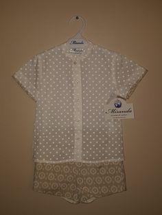 Miranda Textilesin paita ja housut. Paita on valkoinen ja siinä on valkoisia pilkkuja. Housut ovat vaaleanruskeat ja niissä on valkoinen kuviointi. www.nellikki.fi