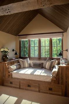 Rustic Living Room with Standard height, Paint, Exposed beam, picture window, Carpet, bedroom reading light