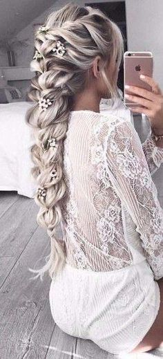 Love the lower part of this braid with the flowers going down the braid
