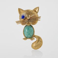 """""""Van Cleef & Arpels Paris Turquoise, Diamond, Blue Sapphire and Gold Cat Brooch Circa: 1960's"""" (quote) via macklowegallery.com What a cutie!"""