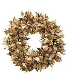 A shimmery accent for your home's exterior, this faux-leaf wreath can play up bright lights and other colorful decorations or stand on its own as a chic neutral piece. Mount it on your door, and use it year after year.