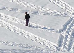 It Looks Like A Crazy Guy Just Walking Around In The Snow. Then You Zoom Out And.. Whoa.