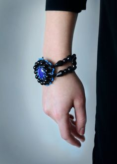 black and blue circle glass bracelet - beadwork jewelry for women - chunky party cuff - owl bracelet - beadwork bracelet - designers jewelries by RasaVilJewelry Black and blue bridesmaid bracelet - one of the ooak beadwork jewelry - original chunky big bracelet for weddings - bridal cuff - round, circle bracelet.  Black and blue bracelet made for seed beads, glass bead, czech glass, natural leather and metal detail. In the middle is glass bead, which is more violet than blue. Perfect for all…