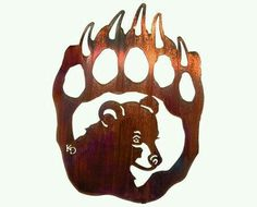 Bear tattoos are another popular arts in the modern trend depicting various meanings. Have a look at the top bear tattoo designs Metal Wall Sculpture, Wall Sculptures, Metal Wall Art, Wood Art, Bear Paw Tattoos, Bear Claws, Wood Burning Patterns, Scroll Saw Patterns, Bear Art