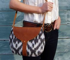taplin purse: black and white ikat, leather, and brass | shelter protects you