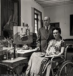 Meta moment: Frida Kahlo and Dr Juan Farill were photographed in her home in 1951. In his photo, they are standing in front of one of her works in which she pictured herself painting Dr Farill's portrait