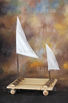 Hey, I found this really awesome Etsy listing at https://www.etsy.com/listing/183457089/real-wood-raft-boat-with-sails