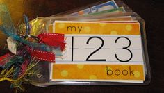 123 Book ~ Print it out on Photo Paper, cut out the pages & put them in Badge Holders. The kids can use Dry Erase Markers on the pages to practice writing numbers. Instead of having the kids draw pictures, add Stickers so they could also just look at the book & count the stickers.