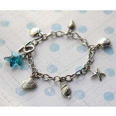 Seashell Silver Charm Bracelet with Aqua Blue Swarovski Crystal Starfish. via Etsy.