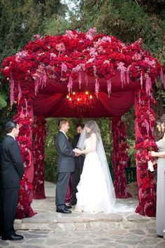 This red wedding chuppah is a real show stopper! Very elaborate, complete with a chandelier. I'm not sure how many brides get to have a chandelier in their chuppah. Wedding Ceremony Ideas, Wedding Events, Outdoor Ceremony, Ceremony Arch, Outdoor Weddings, Autumn Wedding, Red Wedding, Wedding Flowers, Cranberry Wedding