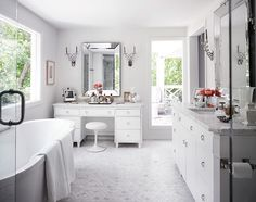 Master bathroom with soft gray walls paint color, marble hex tiles floor, freestanding modern tub, extra-wide bathroom cabinet with marble countertop, white bathroom vanity with marble countertop and beveled mirrors. All White Bathroom, Master Bathroom, White Bathrooms, Bathroom Marble, Classic Bathroom, Small Bathroom, Bath Tiles, Luxury Bathrooms, Bathroom Spa