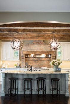 Despite paying homage to the home's history, the kitchen design doesn't sacrifice the convenient comforts of modern amenities.