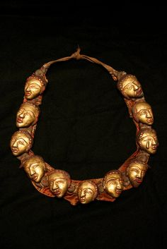 Tibetan shaman necklace Age: 18th C Brass, gold plate, fiber, pigment 50 (Height) cm