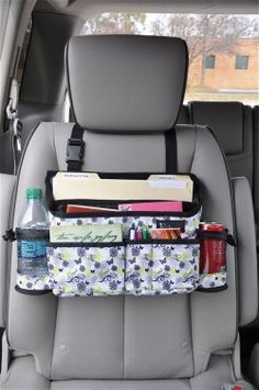 I could make one of these! Swing Away (Green Butterflies) - Who couldn't use a little extra space in their car? Slip the adjustable strap over any car seat and you'll instantly create just that! Swing this carrier to the front side of the passenger seat for those who need an office on the go! Has one large file pocket for papers, magazines and folders, five pockets for cell phones, PDA, glasses, CDs, etc., and two mesh side pockets for drinks, wipes, mints, etc. (18 x 4 x 9) Item 0413-GB $30...