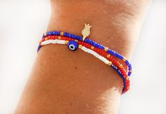 Bracelet set red seed beads white heishi beads evil eye blue seed beads gold plated tulip navy blue best friend birthday. $15.00, via Etsy.