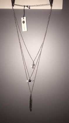 Bay to Baubles Stitch Fix  necklace with rose quartz and silver feather - absolutely my style!