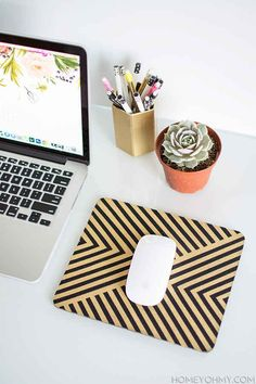 Spruce up your mousepad with some paint and tape.