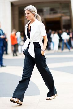 Minimize your waist with a wrap blouse // wearing all black + white tie-front wrap blouse + white sandals