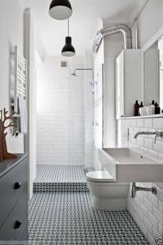 Henley tiles Like: decorative floor tiles, subway tiles & glass see through shower, square sink